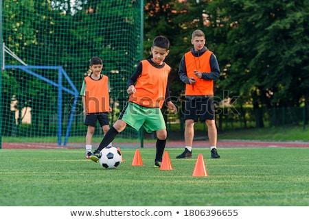 Fiú labdarúgó képzés fiúk fut ugrik Stock fotó © matimix