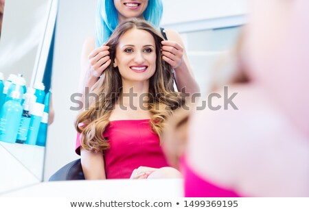 Customer being very happy with the hair styling she received Stock photo © Kzenon