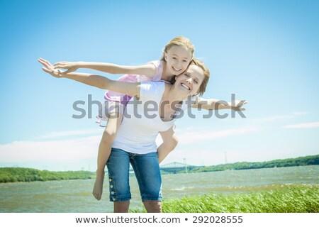 moeder · dochter · zwemmen · zee · familie · kinderen - stockfoto © lopolo