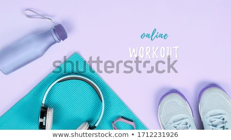 sports top, ball, fitness tracker and water bottle Stock photo © dolgachov