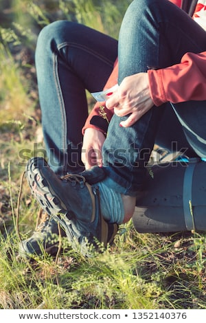 Applying a plaster aid on foot due to tight shoe Stock photo © przemekklos