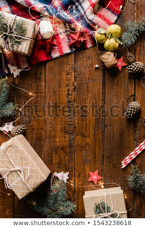 Wrapped giftboxes, garlands, Christmas decorations, pinecones and conifer Stock photo © pressmaster