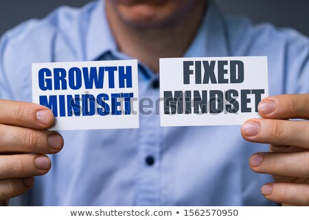 Man Showing Growth And Fixed Mindset Cards Stock photo © AndreyPopov