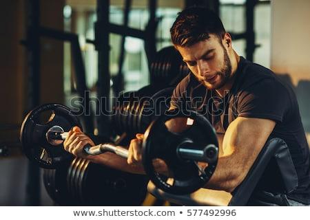 Macho człowiek wagi sztanga muskularny Zdjęcia stock © Jasminko