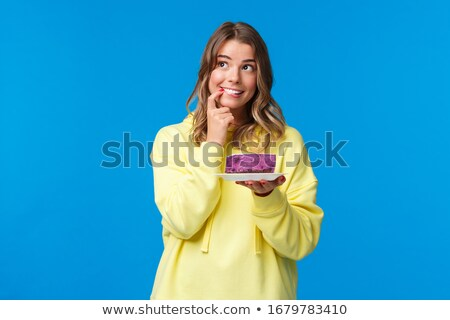 University / college student girl looking happy smiling with boo Stock photo © Lopolo