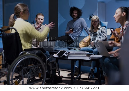 Biznesmen posiedzenia wózek biuro działalności Zdjęcia stock © AndreyPopov