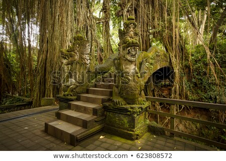 An ancient stone carving in Sacred Monkey Forest Sanctuary in Ub Stock photo © boggy