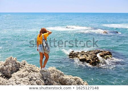 Female tourist wanderlust with backpack wearing sunglasses and s Stock photo © dashapetrenko