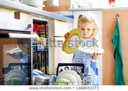 Little girl lava-louças cozinha casa crianças grávida Foto stock © AndreyPopov