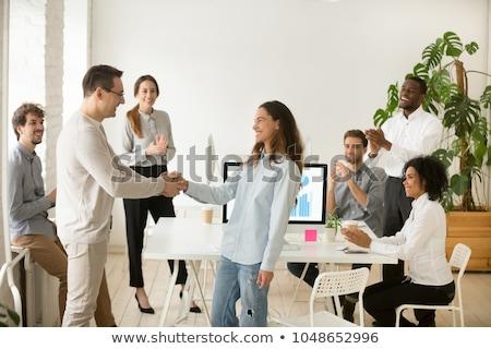 Businessman Congratulating Success Of Female Colleague Stock photo © AndreyPopov