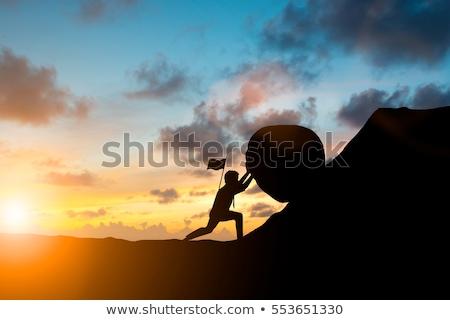 Trabalho duro homem empurrando esfera para cima seta Foto stock © orla