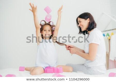 радостный довольно женщины ребенка голову рук Сток-фото © vkstudio