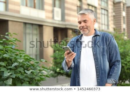 Gelukkig senior man smartphone zomer Stockfoto © dolgachov