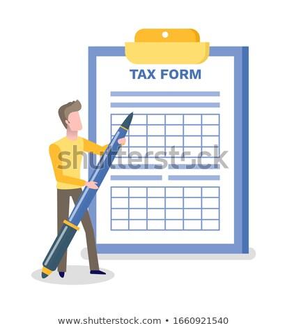 Tax Form Man Holding Big Pen Writing on Blank Stock photo © robuart