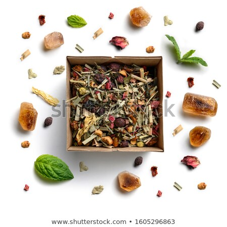 Herbal tea, mint and caramel sugar on a white background. The view from the top Stock photo © butenkow