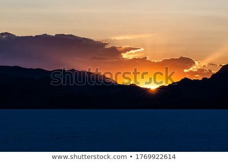 Coucher du soleil derrière montagnes soleil mer plage Photo stock © fyletto