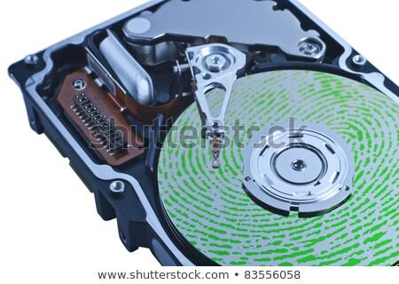 open hard drive with green fingerprint on platter Stock photo © gewoldi