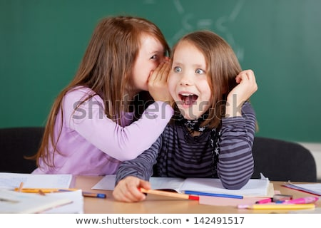 Dois meninas fofoca sala de aula menina escolas Foto stock © HASLOO