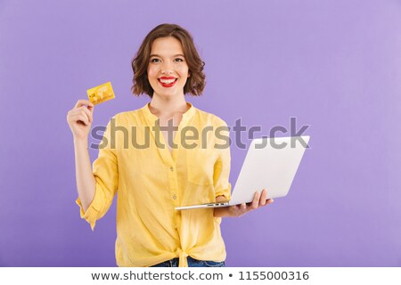 portrait of beautiful business woman with laptop and credit card stock photo © hasloo