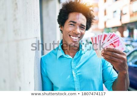 Business man holding money Stock photo © dotshock