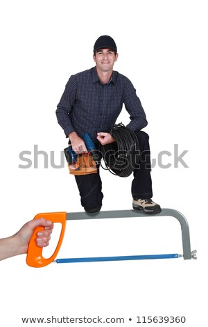Handyman with drill standing on giant hacksaw Stock photo © photography33