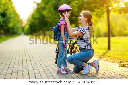 Stock photo: portrait of a woman on a bike