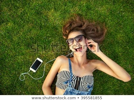 улыбаясь · счастливая · девушка · трава · таблетка · парка · девушки - Сток-фото © borysshevchuk