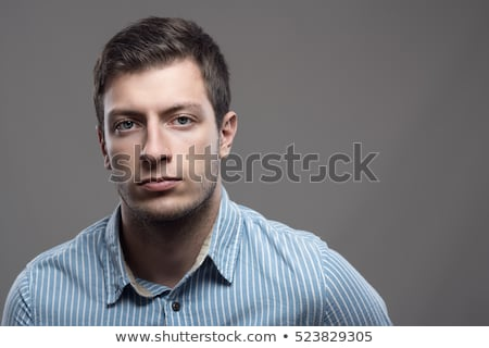 Serious young man with unshaven face Stock photo © pzaxe