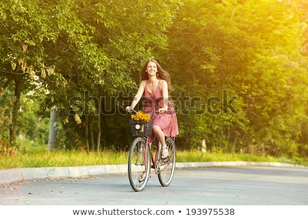 Woman  on the bike in the sunny forest Stock photo © pekour