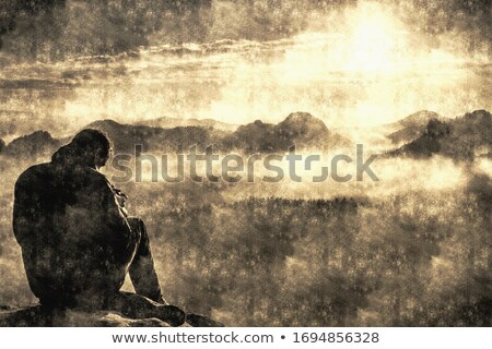 silhouette of the photographer over a foggy mountain stock photo © broker
