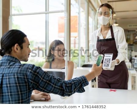 Waitress With Menus In A Restaurant Stok fotoğraf © vichie81