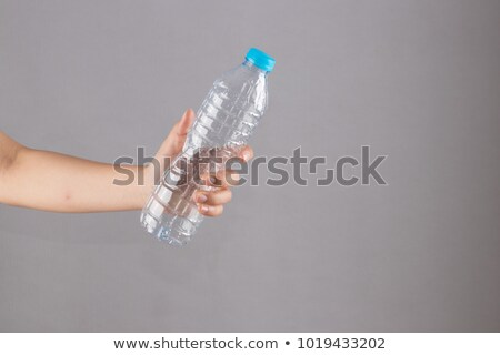 Woman with empty plastic bottles Stock photo © photography33