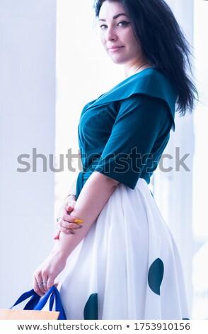 fashion low key portrait, she is turned of three quarters Stock photo © carlodapino
