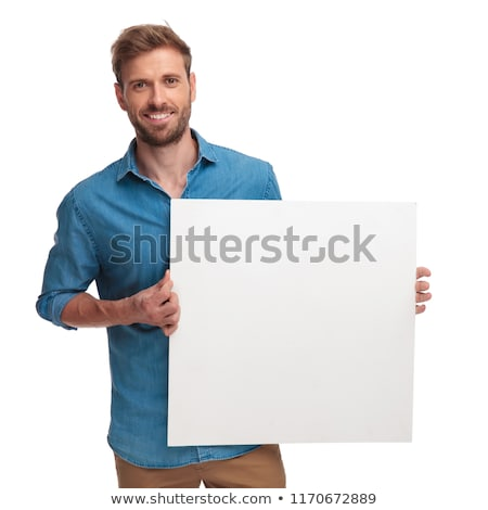 Happy young blonde holding empty white board. Isolated stock photo © acidgrey
