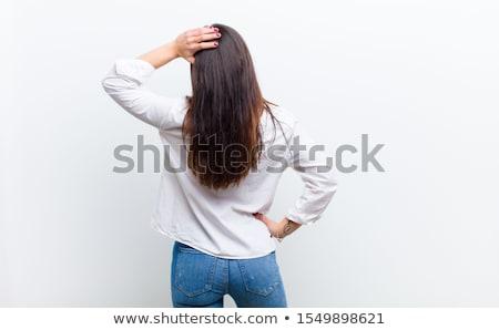 Bonne recherche pensive femme permanent blanche corps Photo stock © wavebreak_media