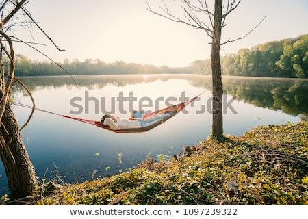 Fiatal lány tó csónakázás felfújható csónak család Stock fotó © val_th