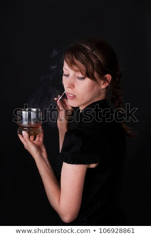 attractiv caucasion woman smoking e-cigarette and holding a drin Stock photo © Pasiphae
