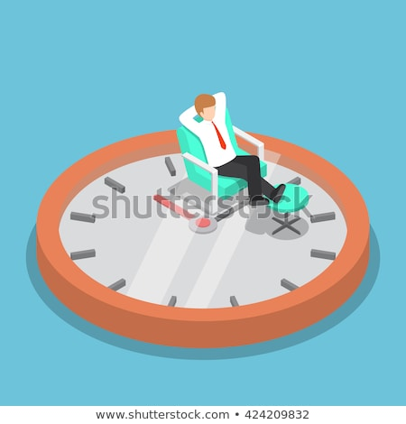 young business man looks up with hands behind head and feet on d stock photo © feedough