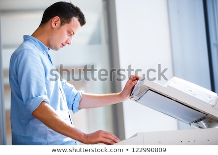 man using a copy machine shallow dof stock photo © pxhidalgo