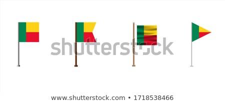 Benin Small Flag on a Map Background. Stock photo © tashatuvango