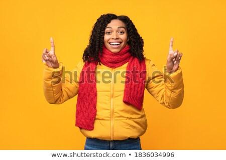 Fiatal nő meleg ruha mutat fiatal felnőtt kaukázusi nő Stock fotó © bmonteny