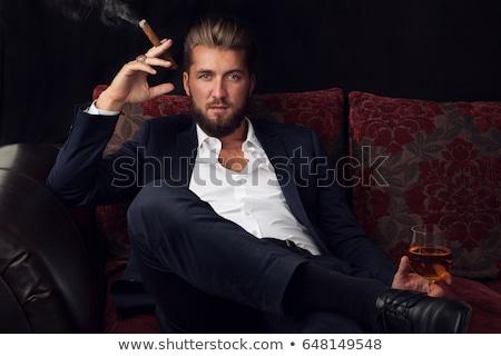 yandan · görünüş · zarif · genç · işadamı · sigara · içme · sigara - stok fotoğraf © feedough