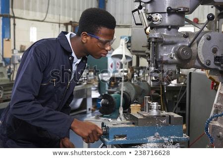 Masculino aprendiz engenheiro trabalhando máquina fábrica Foto stock © HighwayStarz