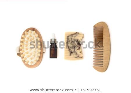 Woman and rake-comb Stock photo © Novic