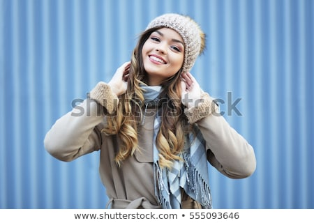 closeup portrait of a young happy woman in warm winter outfit stock photo © deandrobot