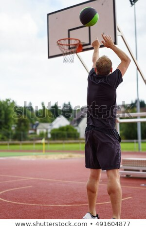 Basketball Man Tossing Ball Stock photo © cteconsulting