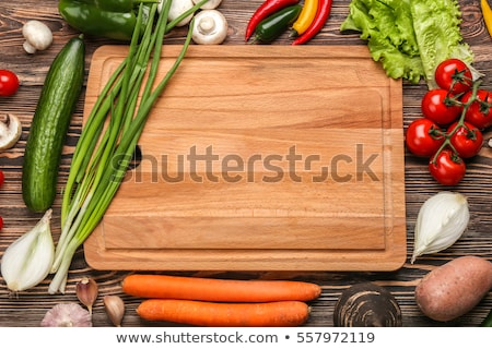 Stock photo: Healthy fresh salad ingredients on a cutting board
