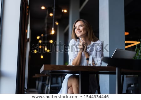 happy businesswoman holding laptop stock photo © deandrobot