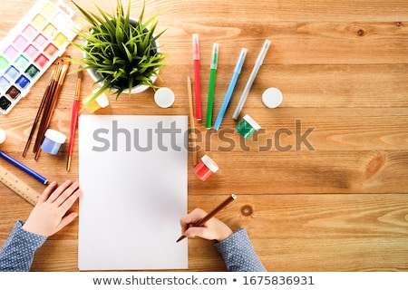 notebook with colored pencils on White background stock photo
