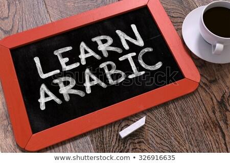 Hand Drawn Learn Arabic Concept on Chalkboard. Stock photo © tashatuvango